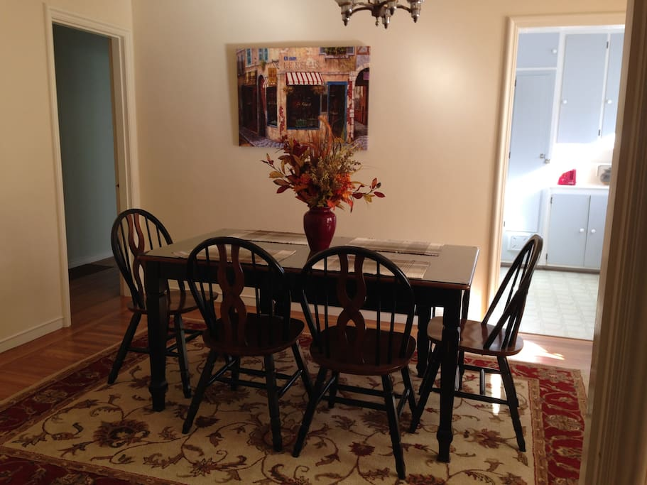 Dining room with 4 chairs and a bench seat