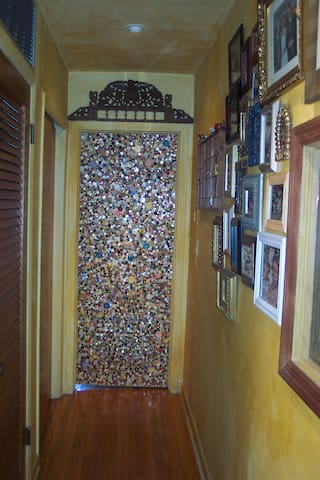 button door leading to the library room