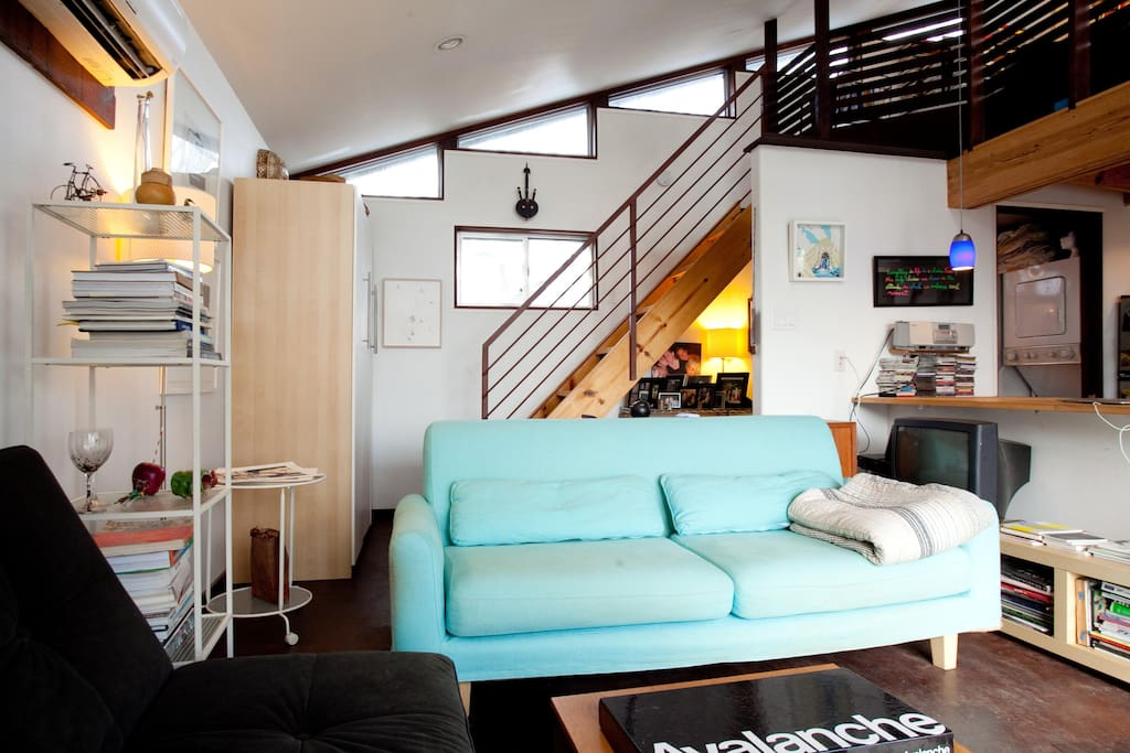 Living area with stairs to sleeping loft.