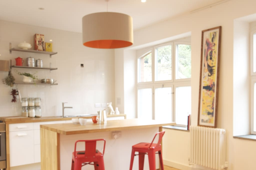Contemporary, stylish kitchen/ diner with breakfast bar & table comfortably fitting six guests.