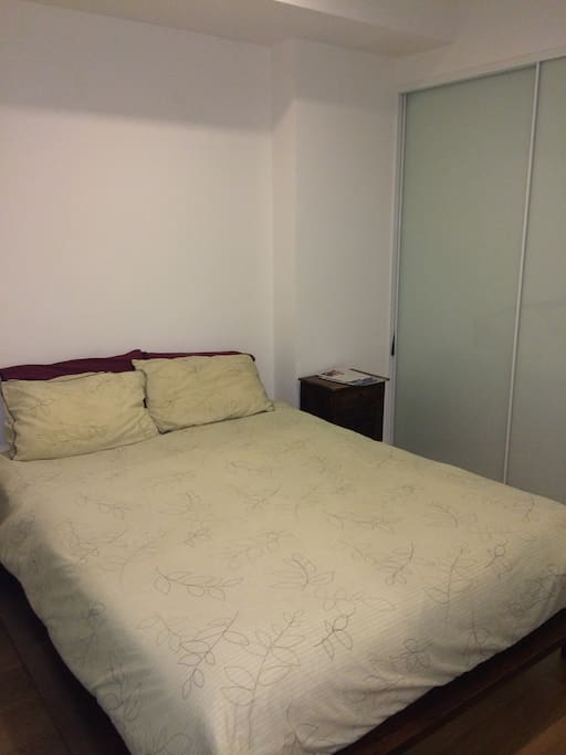 Queen size bed and large wardrobe