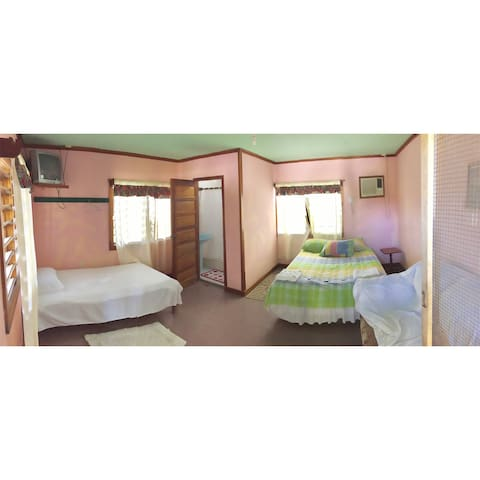 Hotel room with queen bed and single bed with private bathroom. Air condition and screen windows and door.