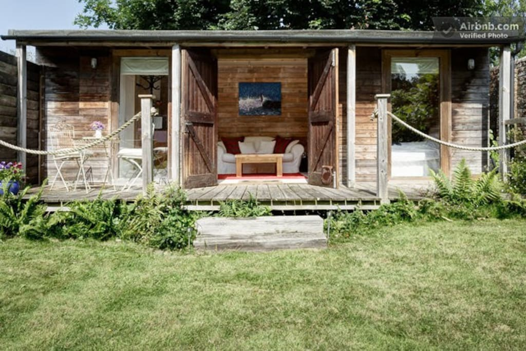 Cosy wood cabin with sunny deck is your private base for your glamping holiday