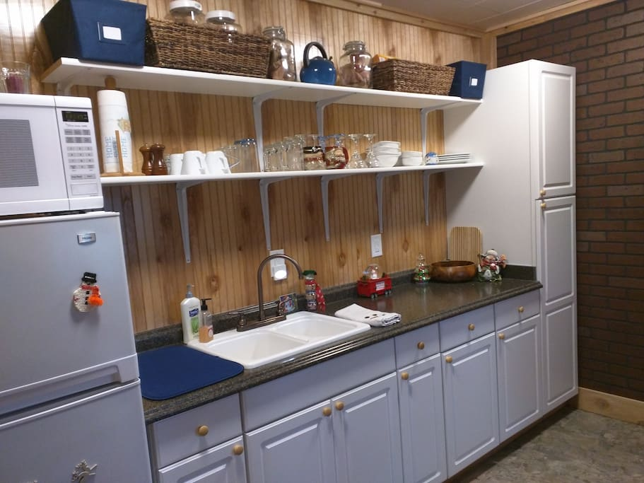 kitchenette area. all the dishes and cooking supplies. Refrigerator, microwave, and hot plate available for food preparation