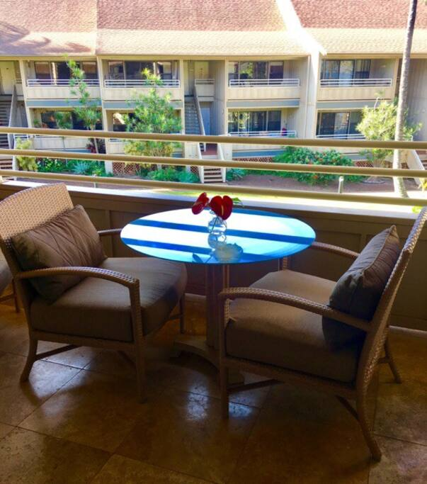 Enjoy coffee and cocktails on our spacious lanai.