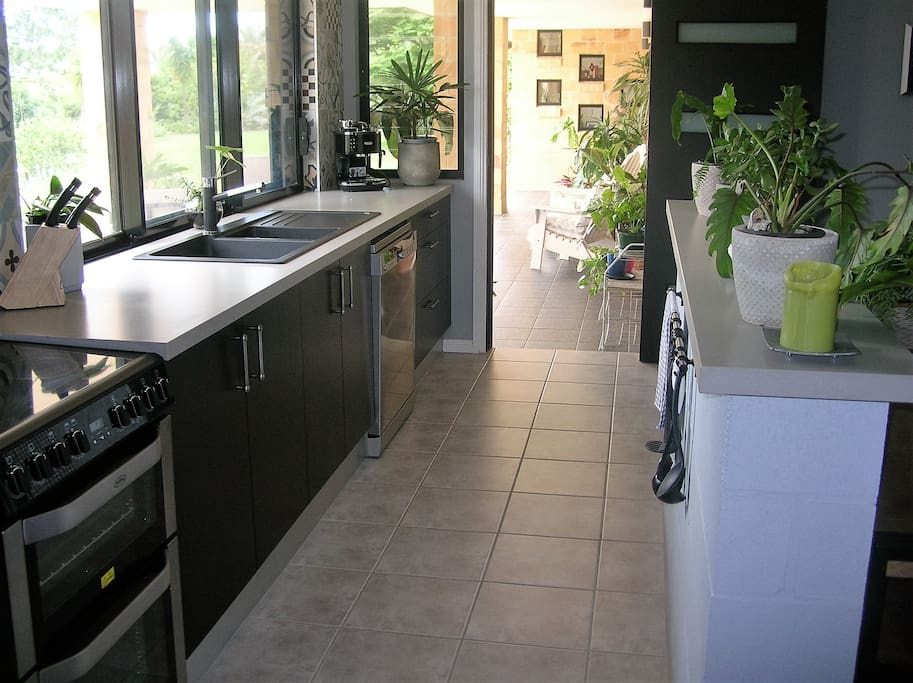Modern kitchen which opens to outdoor area