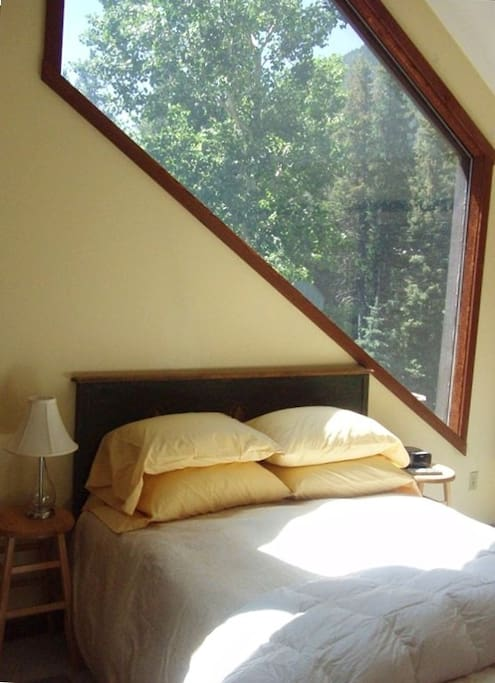 This is the top level master bedroom with huge windows on 3 sides...the views are incredible!