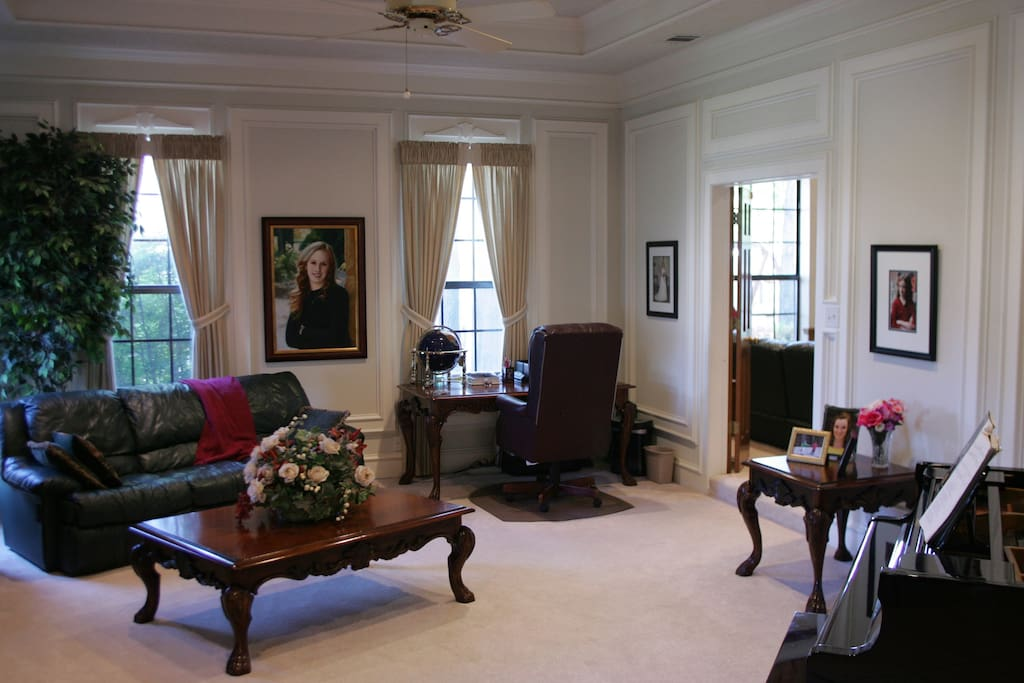 Formal living area is located just off entrance foyer, and has access to the media room.