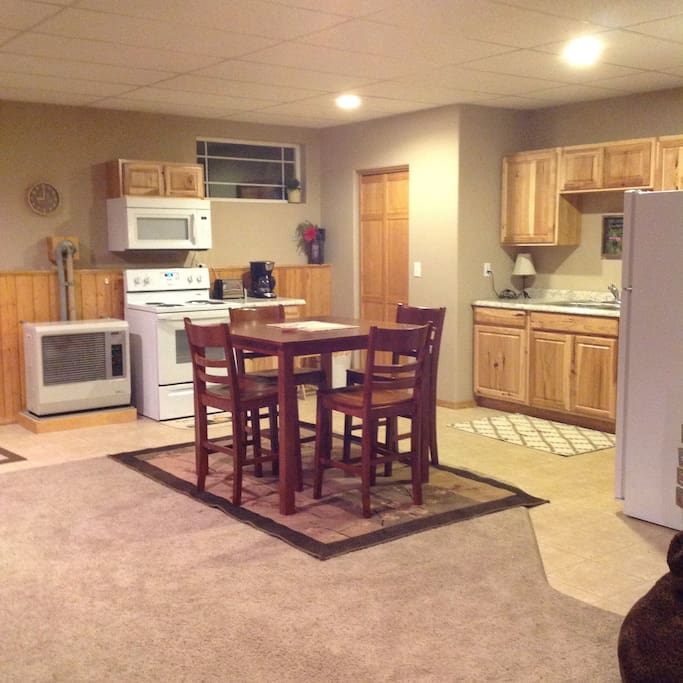 Kitchen area with table and chairs for 4