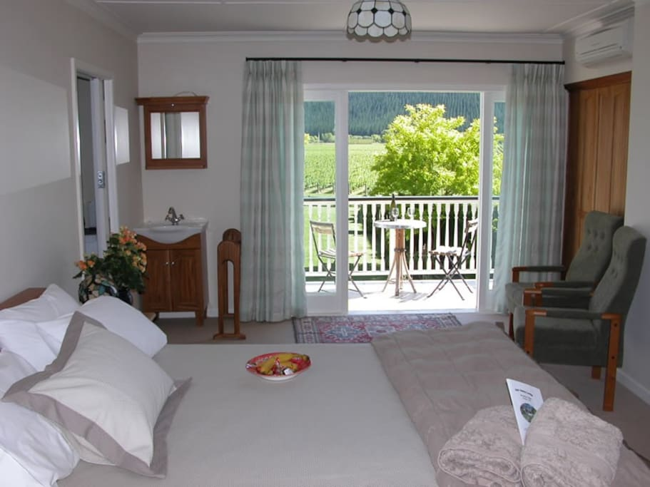 Sauvignon suite bedroom with balcony overlooking gardens