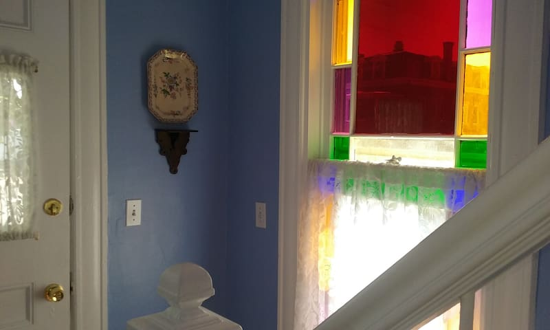 Your entrance -the colored glass jewel tones dance on the wall on sunny days!