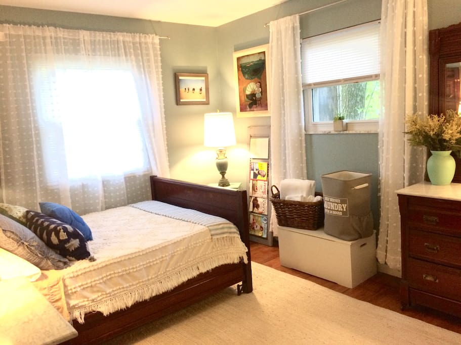 An inviting room with a very comfortable tempur pedic mattress.  Views of our front and side yards with lots of green trees and grass.