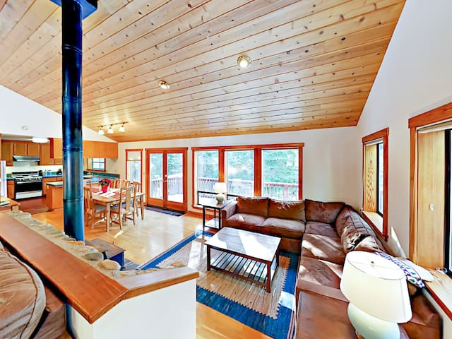 The 2nd living area features a sectional and wood-burning stove.