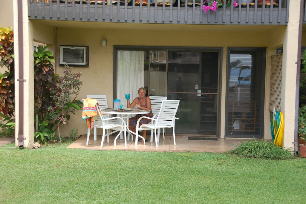 sit on the lanai and look out to a beautiful garden