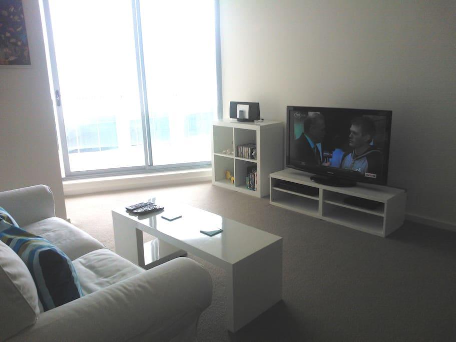 Living area, showing door to balcony