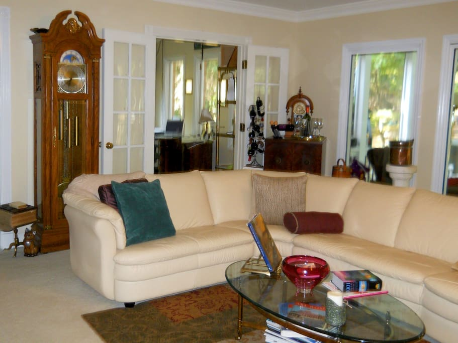 This is the living room of the home and my office is shown in the back of the photo.  A fireplace is located in the living room to the right of the sectional couch.