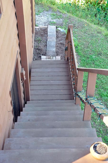 Down the stairway, turn left to the parking space.