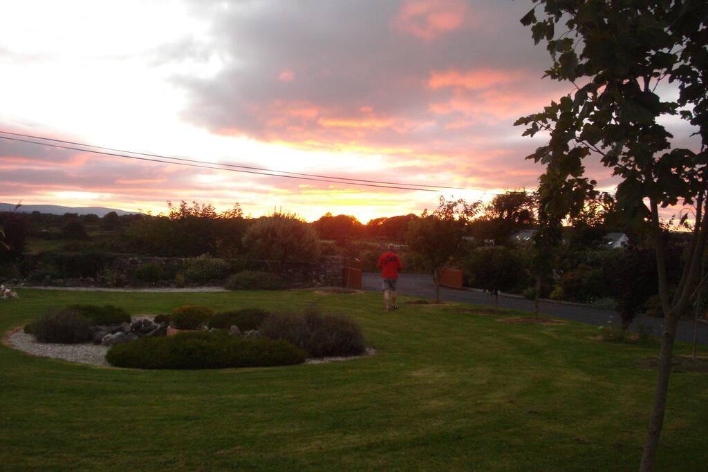 Sunset over our front garden, looking toward Galway Bay.