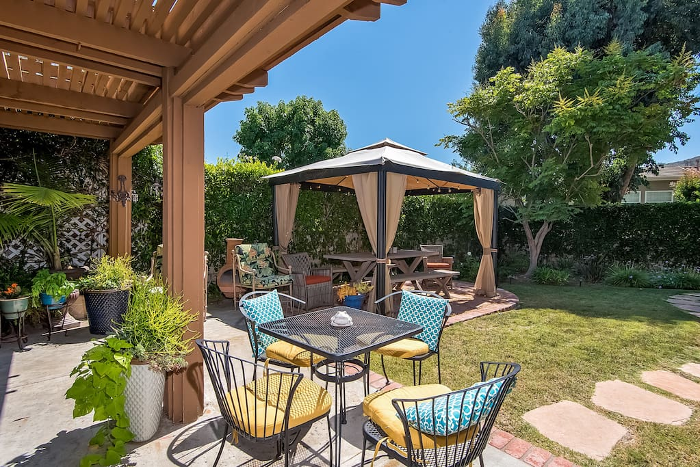 Two outdoor dining areas and an outdoor grill offer lots of dining options