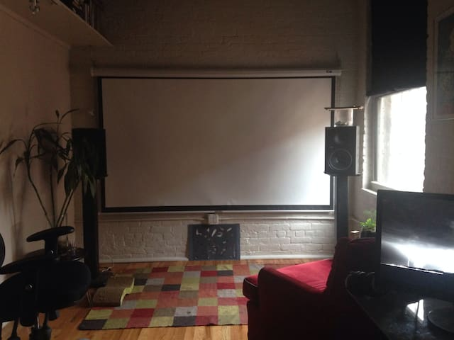 Office/screening room. When available, you can watch movies and surf internet on an 8 foot screen with HD projector.