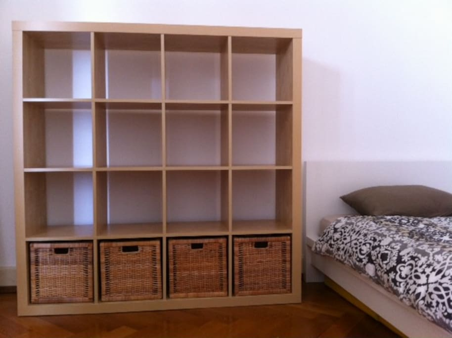 A shelf and a wardrobe : a lot of space for storage
