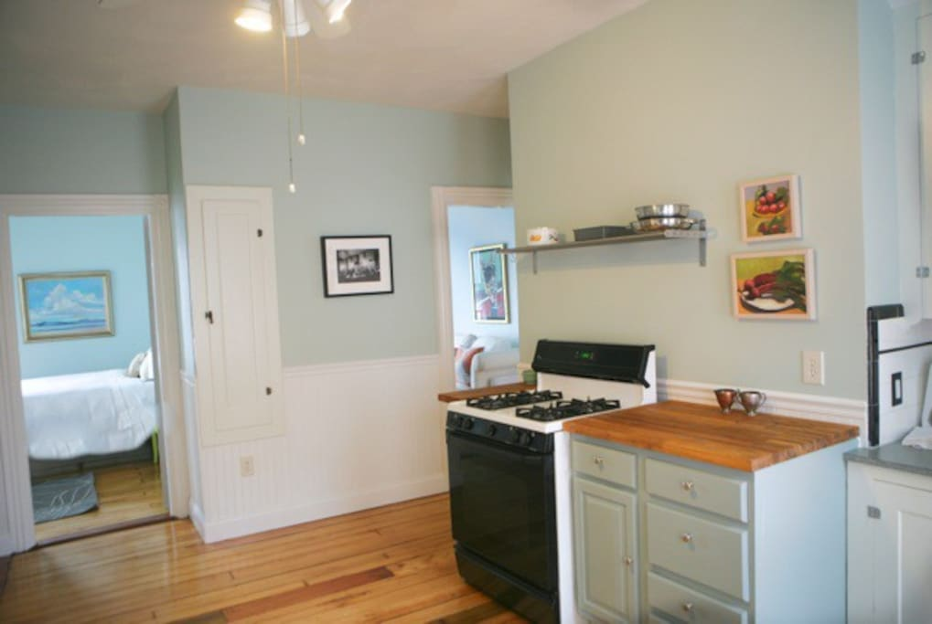 Open kitchen looking toward bedrm. with pull down ironing board