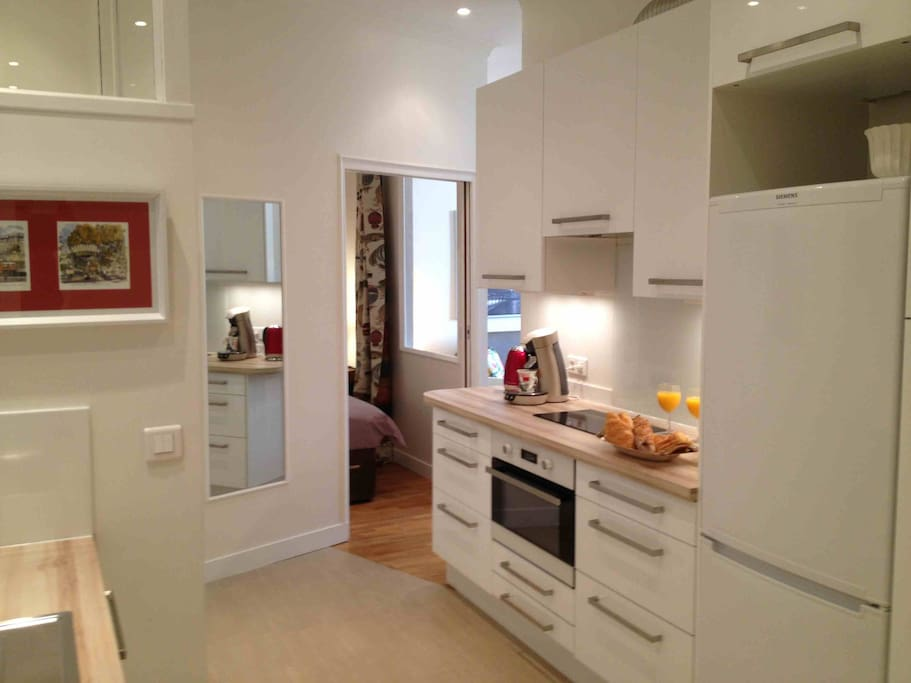 Kitchen with a full size fridge