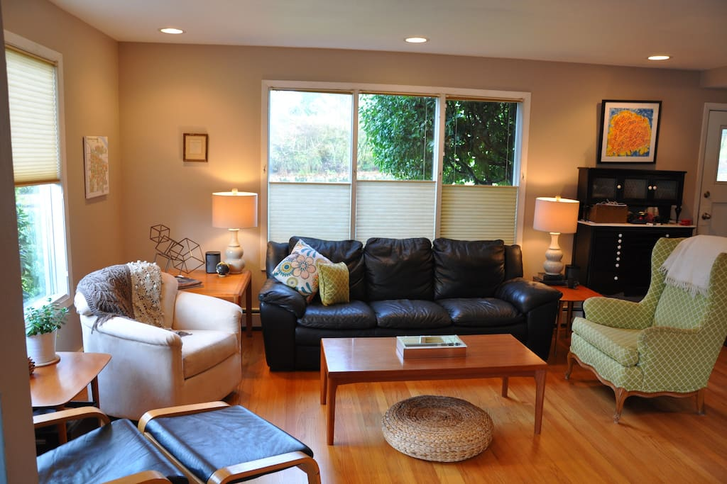 Plenty of seating in the living room and a view of the park across the street.