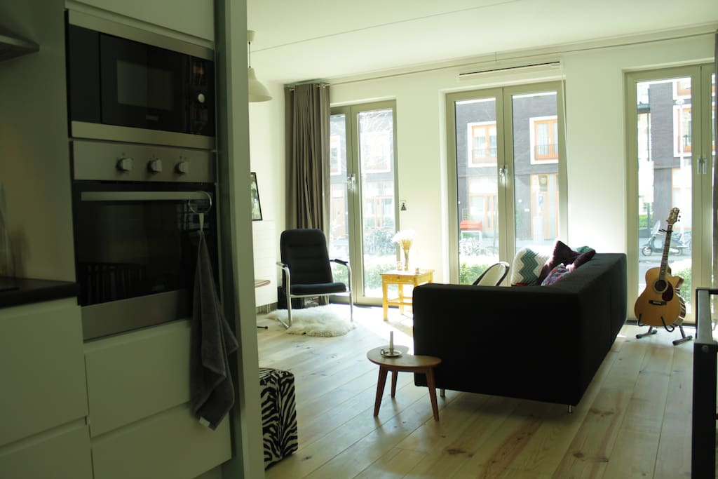 Kitchen is nicely situated between living room and dining room
