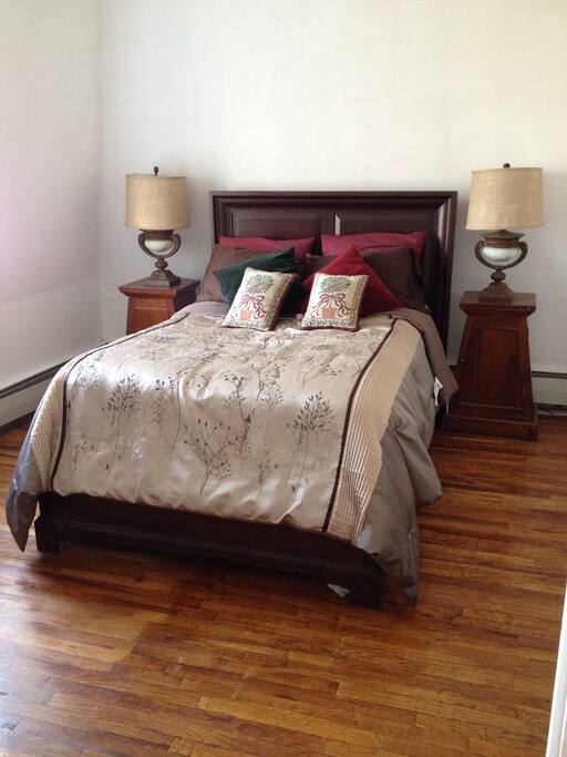Bedroom with full size bed. This bedroom faces the Hudson River
