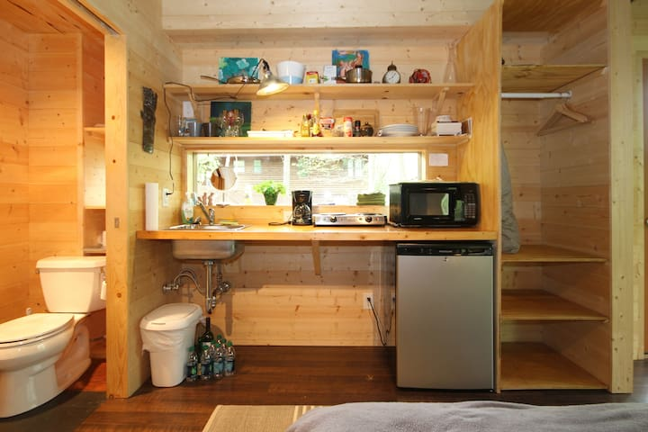 The kitchen area is small - it has a little fridge, microwave and hotplate