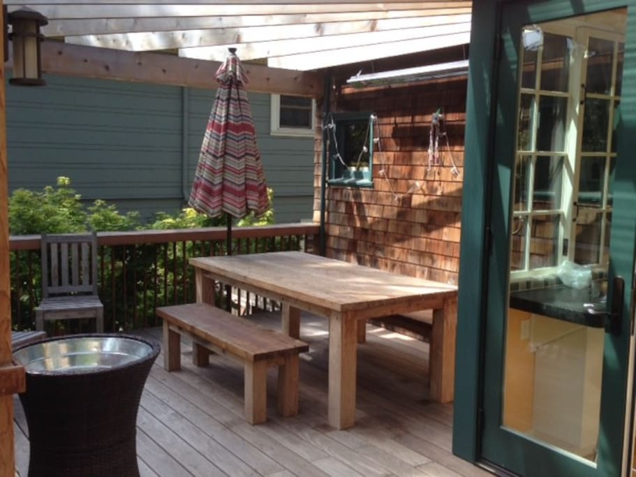 Lots of outdoor space. Large farm table for eating outside, on 2 level deck. At ground level there is also a patio and yard.