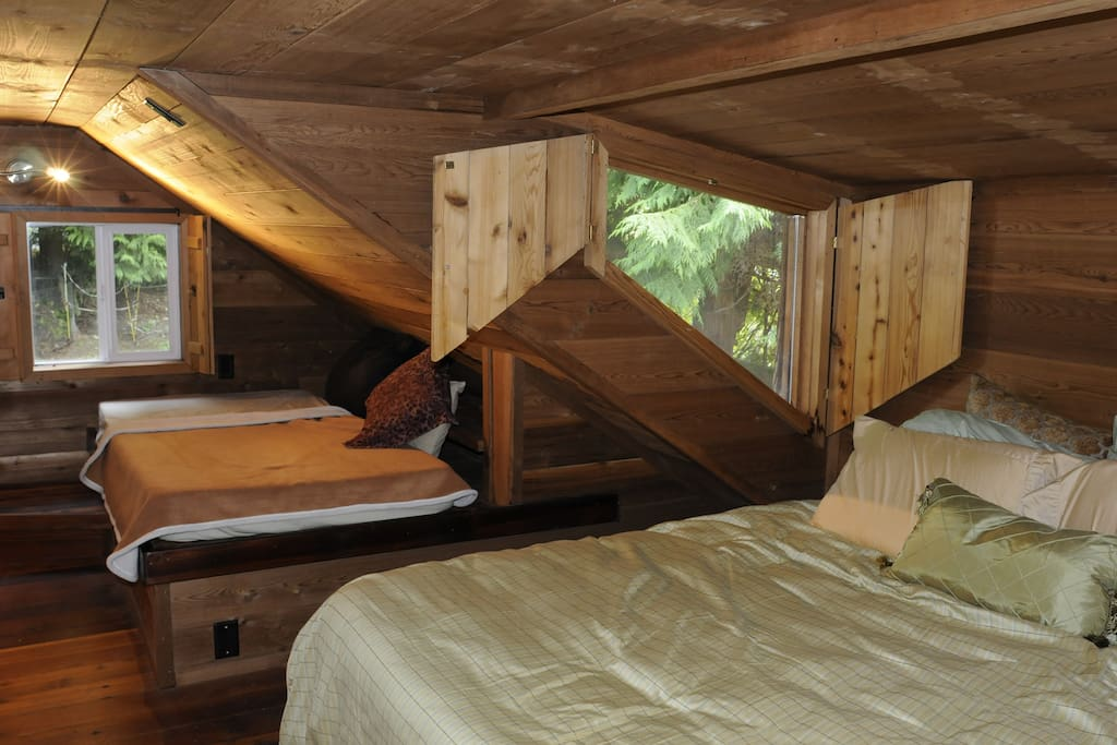 sleeping loft with queen and single bed