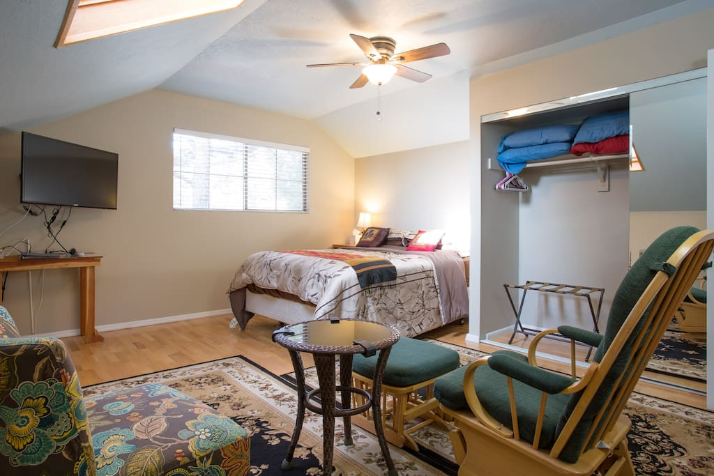 """Sitting area in bedroom with 40"""" flat screen TV"""