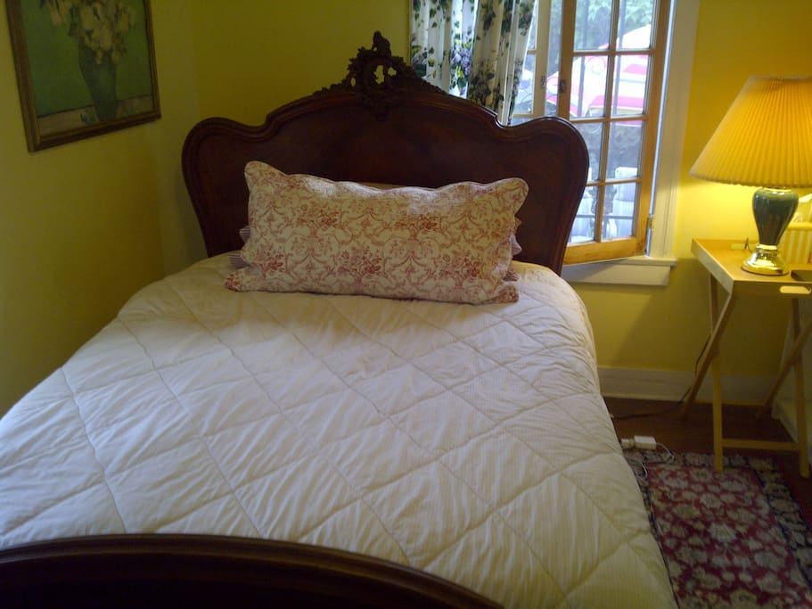 charming antique French full size bed with new mattress and featherbed for extra comfort