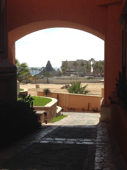 Through the archway to the private beach