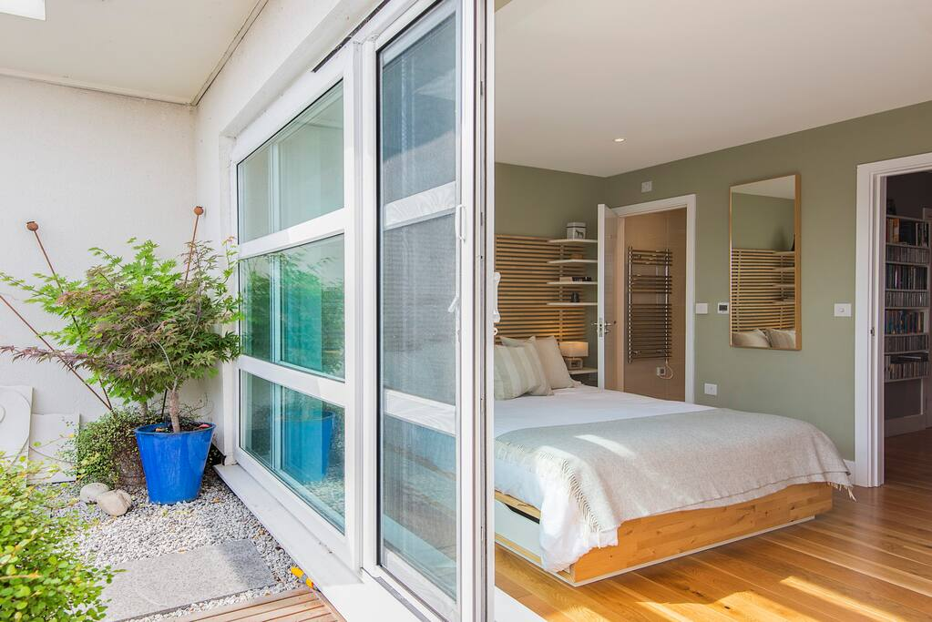 Master bedroom with ensuite bathroom and sliding doors to private terrace