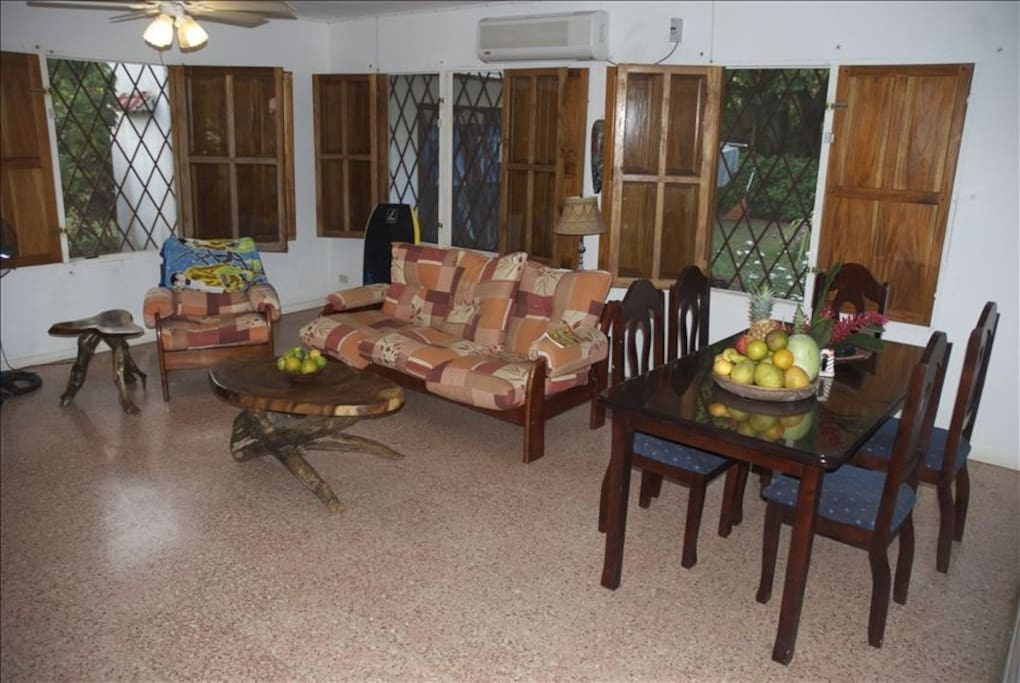 Living room and dining table-- great for relaxing after a long day of enjoying  la pura vida!