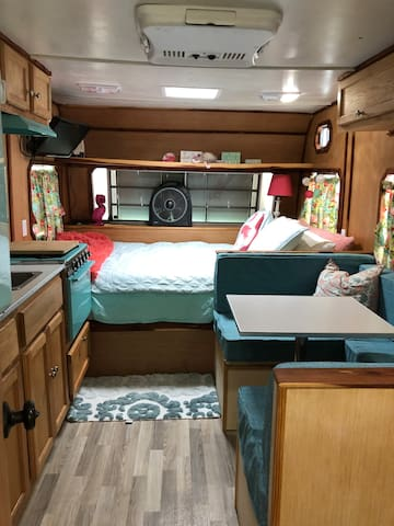Thelma comes with a mini fridge, microwave, and Keurig coffee maker and coffee. There is a new pillow top mattress that is the length of a king bed and the width of a double bed.