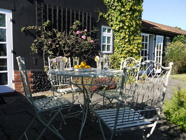 Relax in the  enclosed private garden, including loungers and BBQ