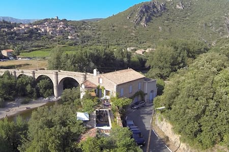 vieussan. net for pictures and details.  La Roque is a beautifully restored winemaker's cottage situated directly on the river Orb in the sun drenched Languedoc. The house is divided into 2 private gites each with direct access to the river where you can swim, kayak (we have kayaks) or relax