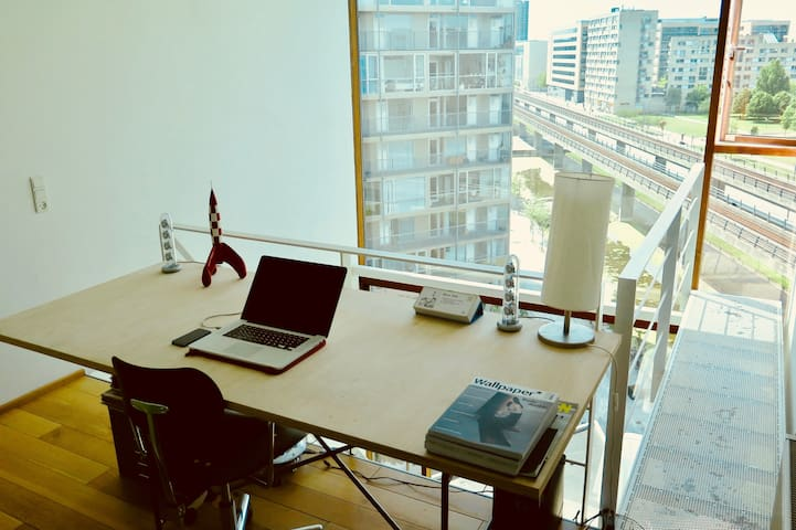 Working desk at upper level with a great view of the park