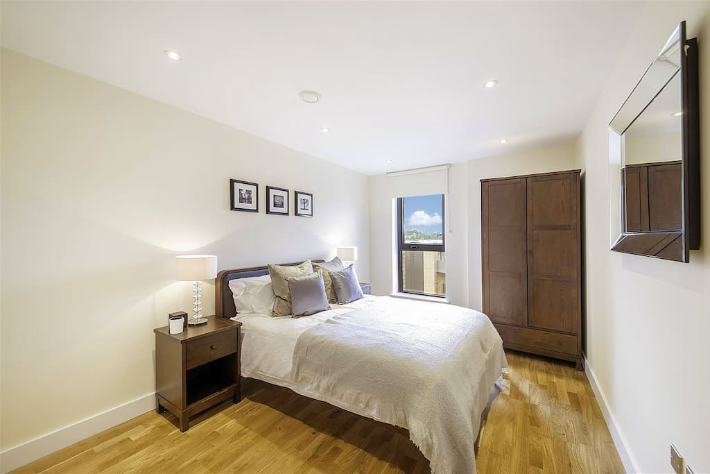 The second bedroom is spacious and furnished with bedside drawers and a wardrobe for your things.