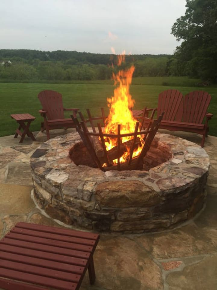 Enjoy the evening around our fire pit out in the side yard.