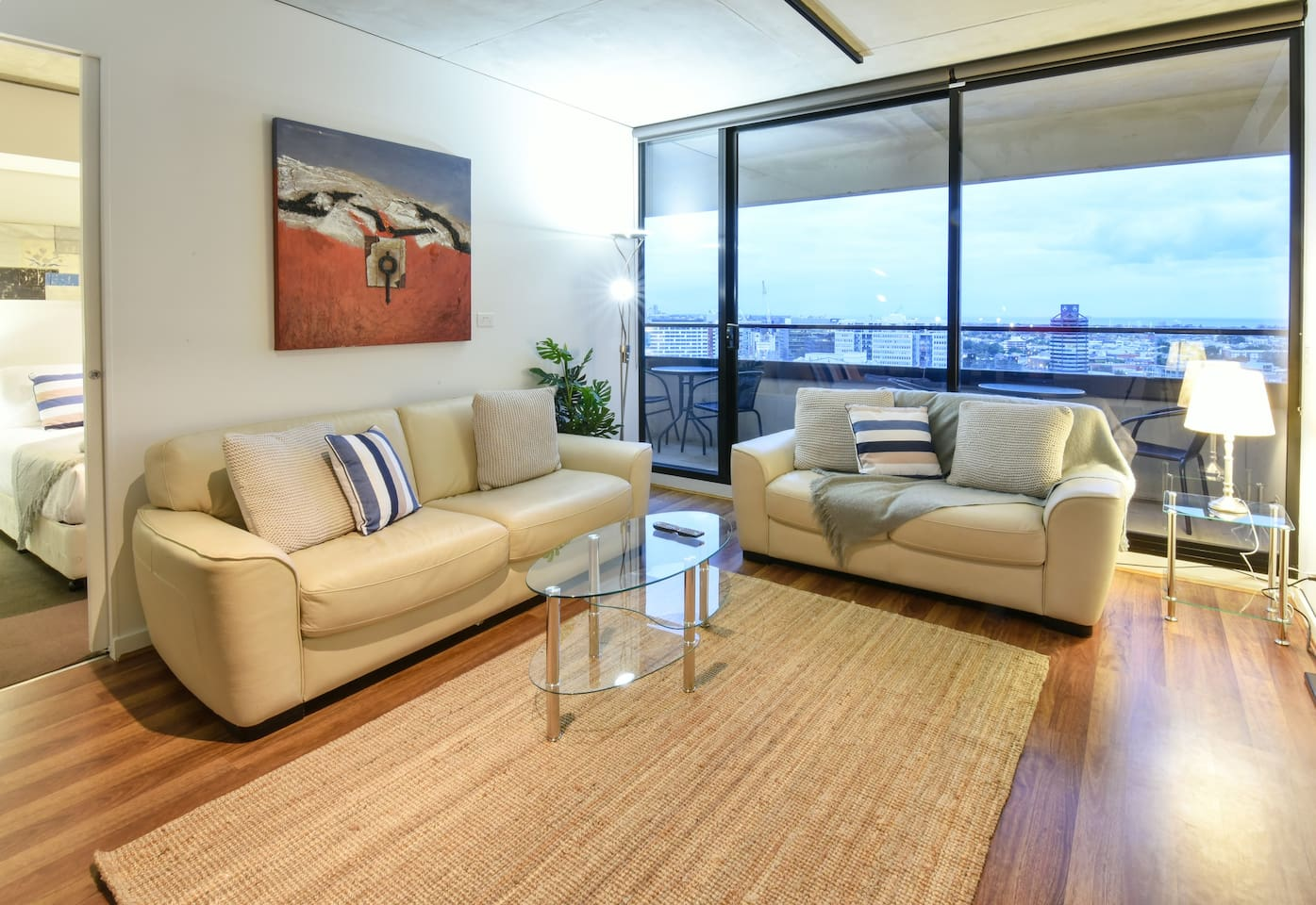 Lounge room with sliding door to balcony and bay views