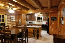 Eat in kitchen with breakfast bar, granite counter tops, and separate dining area.