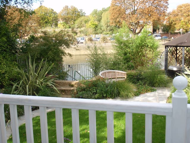 Sit on the decking and watch the boats go by