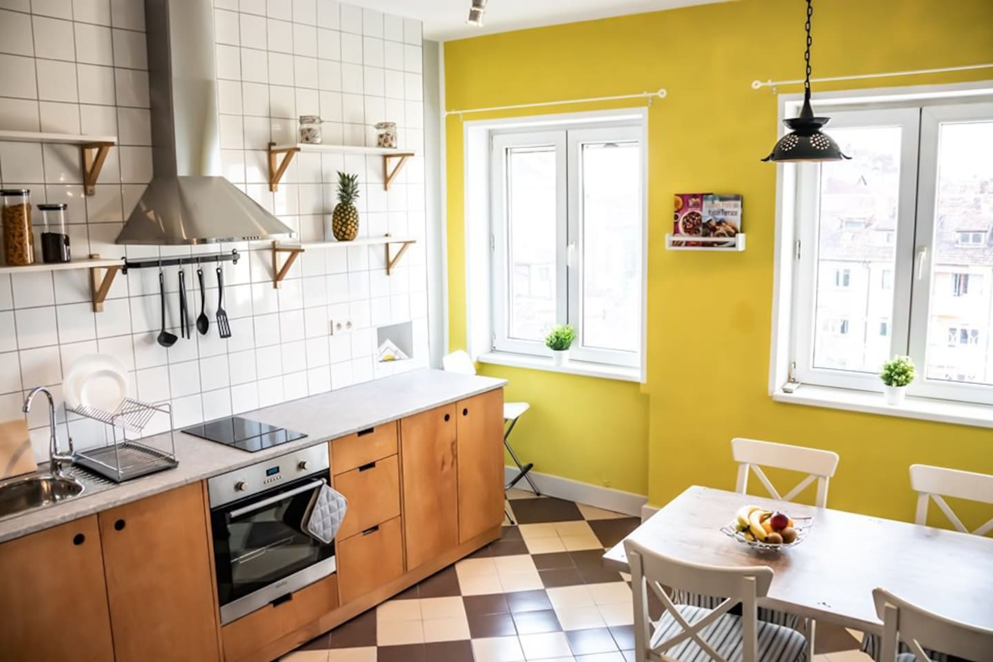 A fully equipped bright kitchen.
