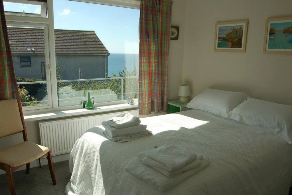 Double bedroom, with ample storage and sea and garden views
