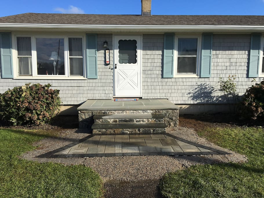 Front entrance and walkway.  This cozy home will welcome you to the sounds of the waves, all within close proximity to everything Narragansett has to offer.